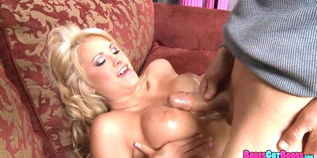 blonde gets her tits oiled up